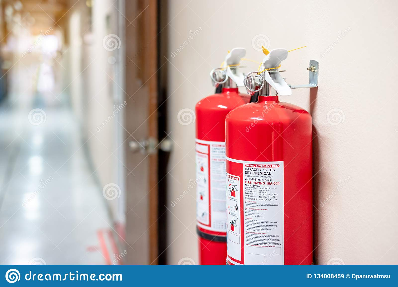 Fire extinguisher system on the wall background, powerful emergency equipment