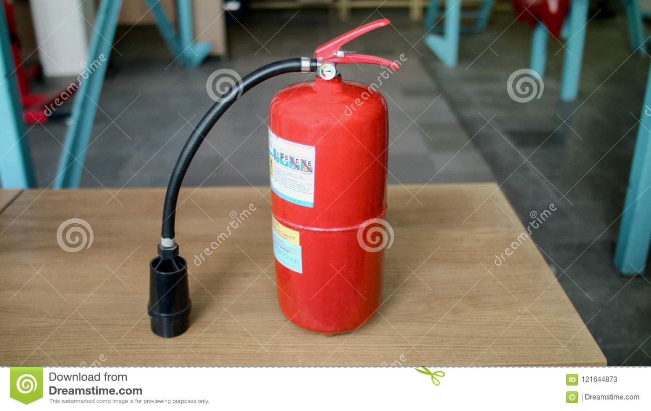 The fire extinguisher is on the table