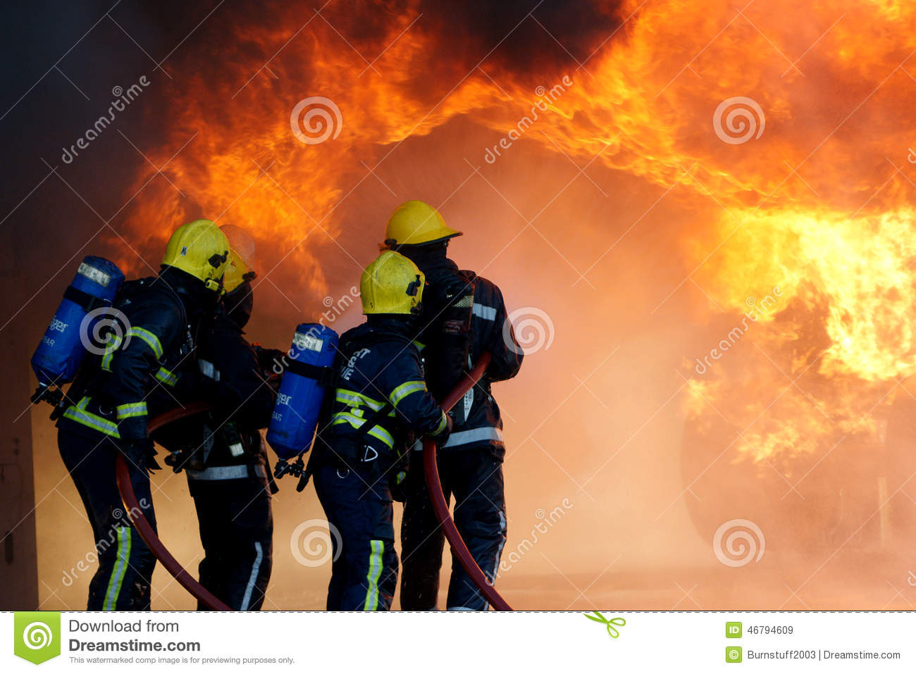 Fire fighters fighting large fire