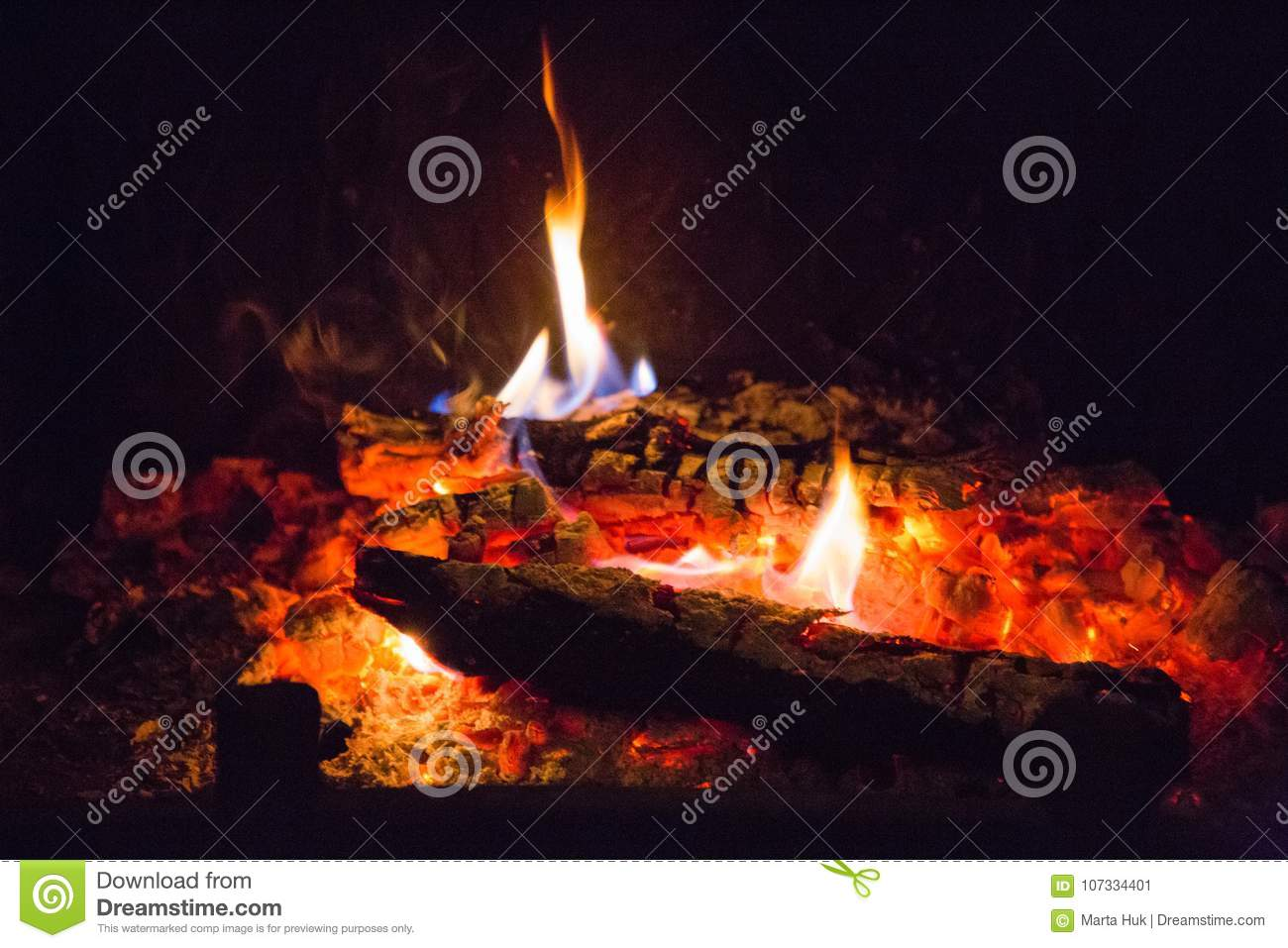 Fire flames with ash in fireplace