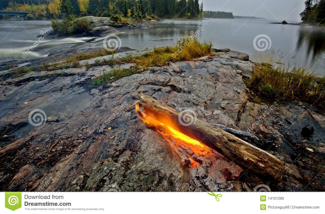 Fire on rock northern canada stock photo image 14101260 for Firerock fireplace cost