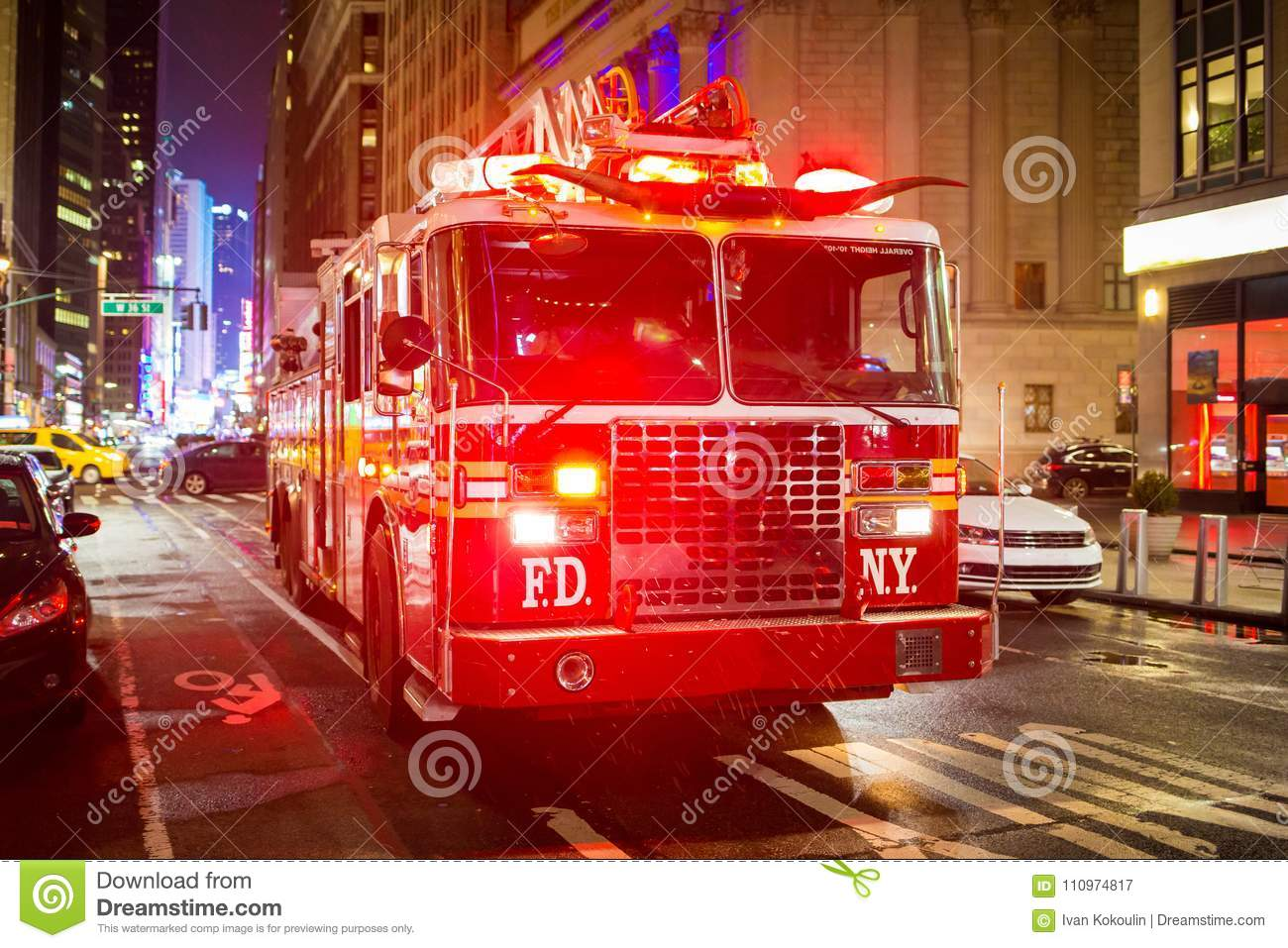 Fire truck with emergency lights on the street