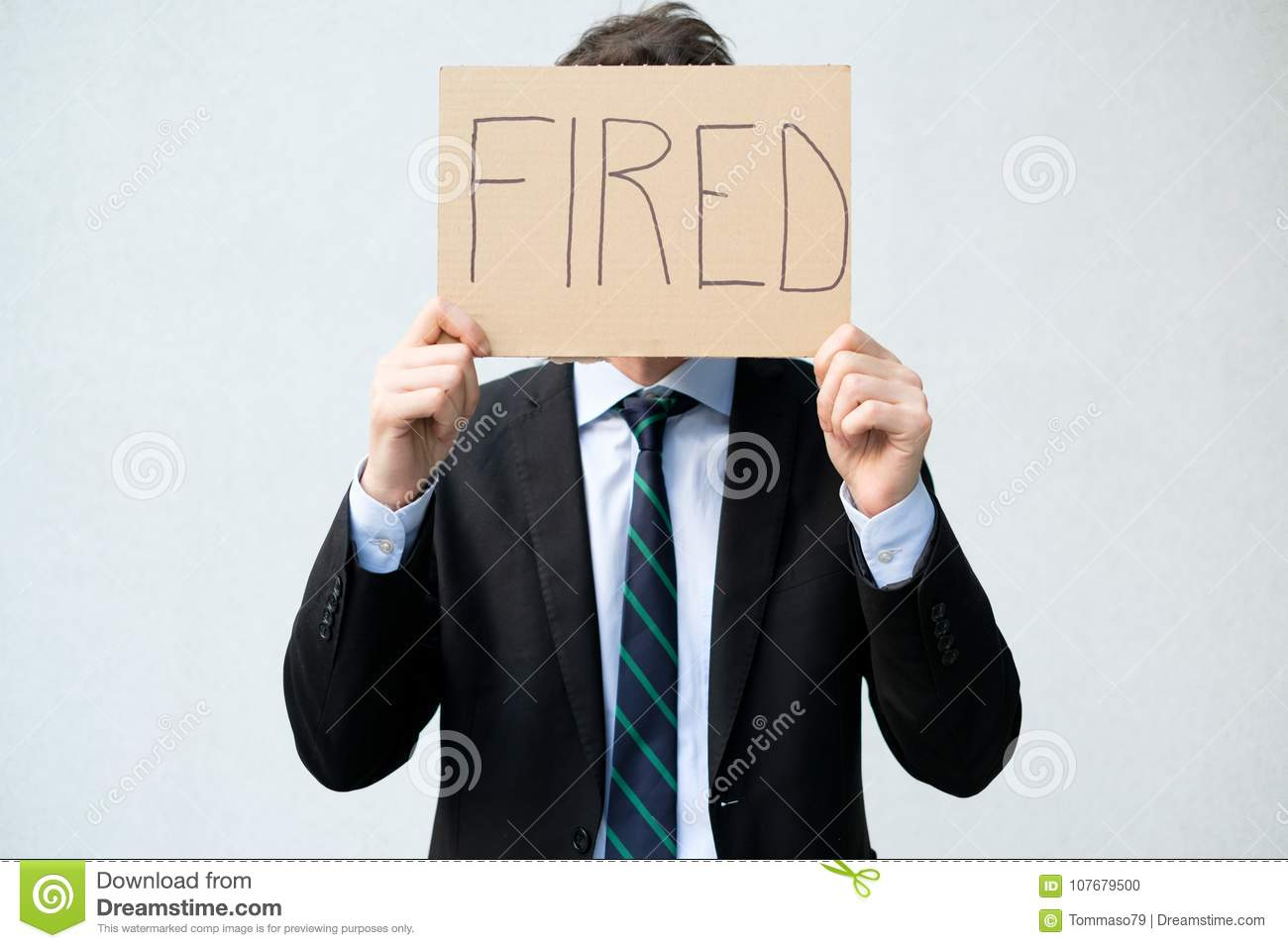 Fired Businessman Hiding His Face With Layoff Stock Photo
