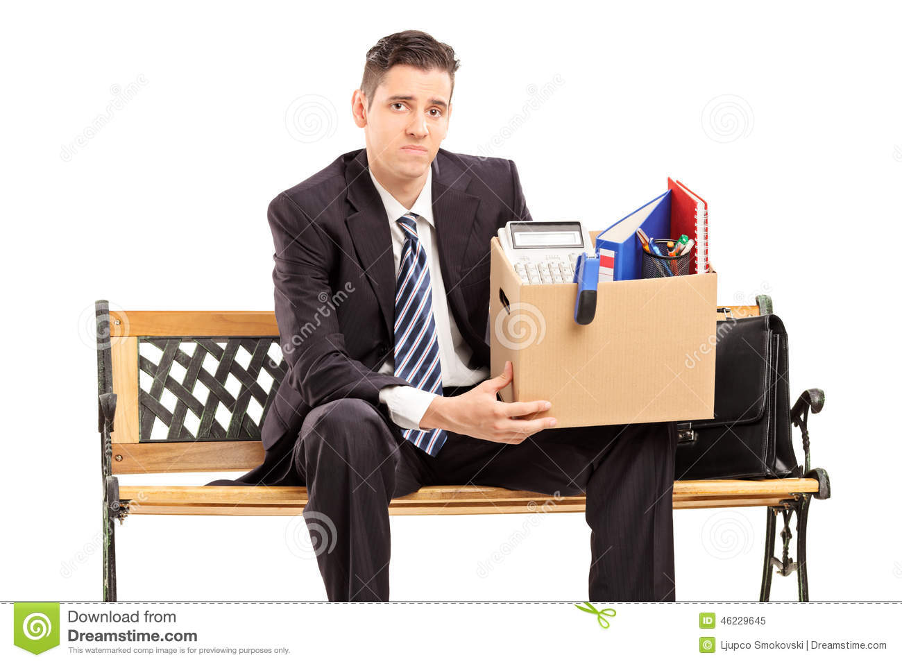 fired businessman holding a box with his stuff stock photo image 46229645. Black Bedroom Furniture Sets. Home Design Ideas