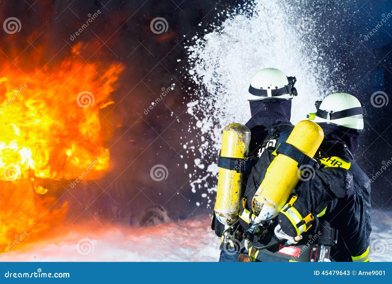 Firefighter - Firemen extinguishing a large blaze