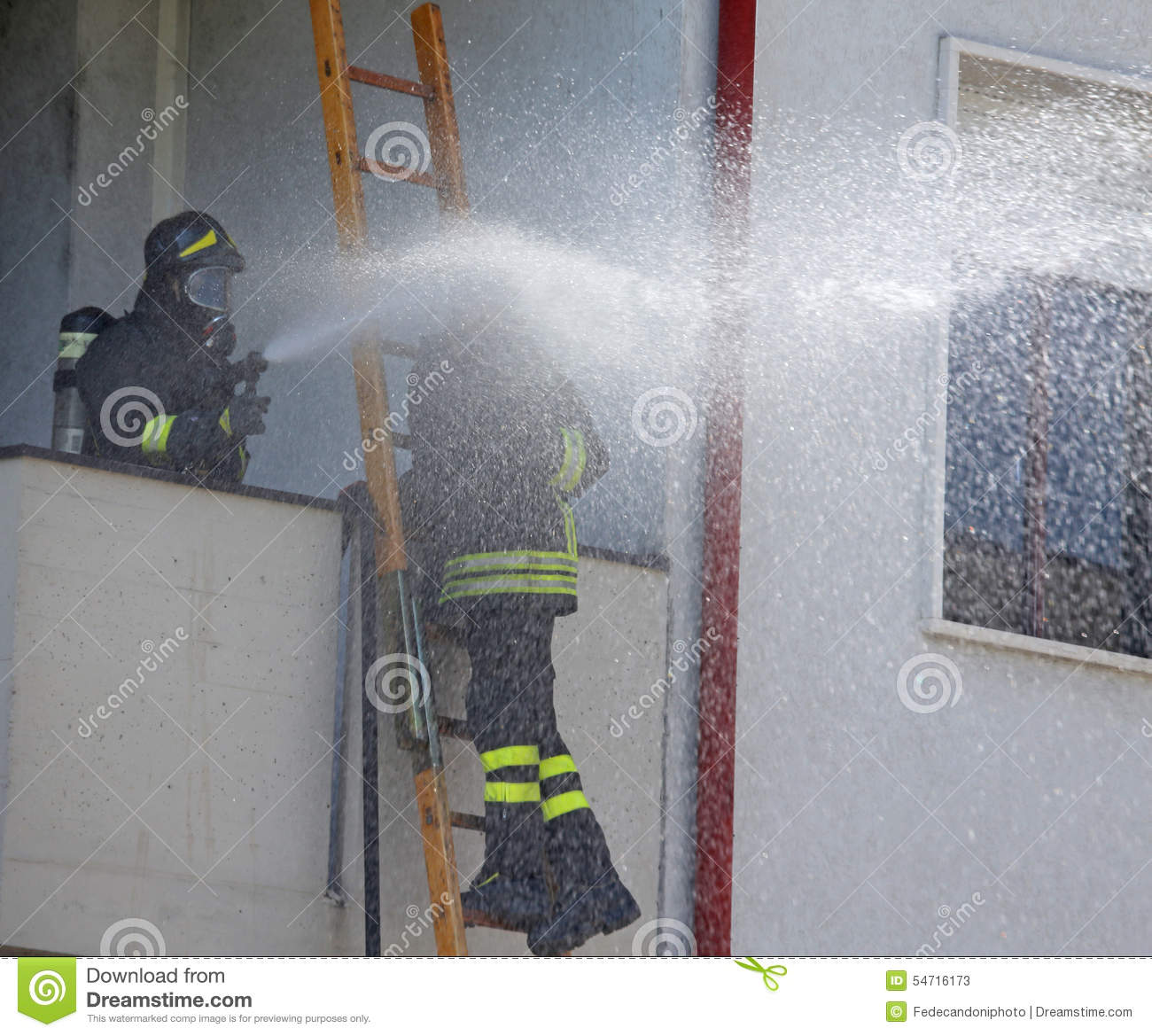 Firefighter Sprays Water With The Spear Fighting Stock Photo - Image ...