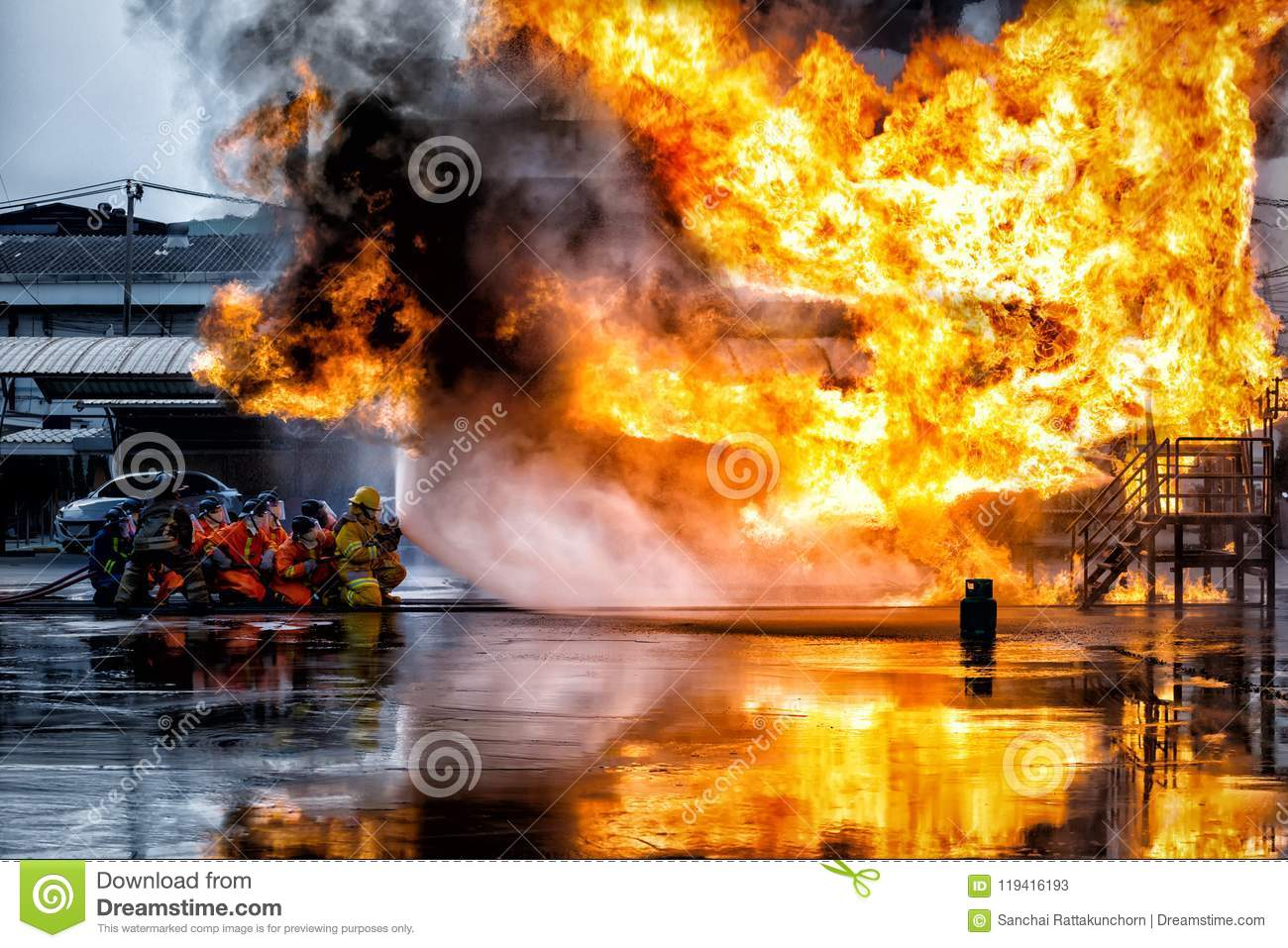 firefighter training., fireman using water and extinguisher to f