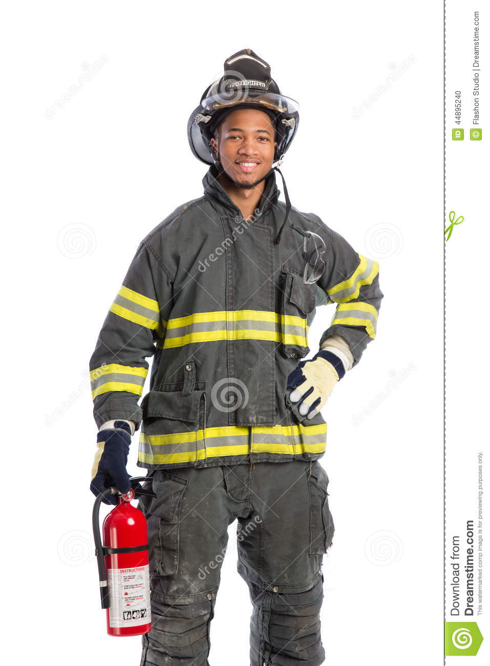 firefighter in uniform holding fire extinguisher stock photo
