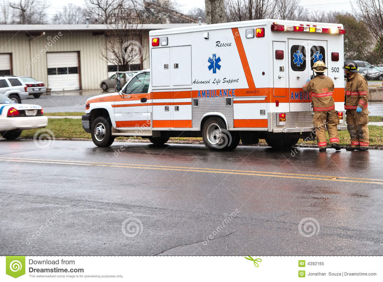Firefighters at an ambulance.