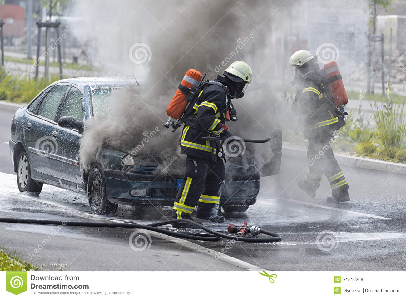 Firefighters Are Putting Out A Burning Car Editorial Photo