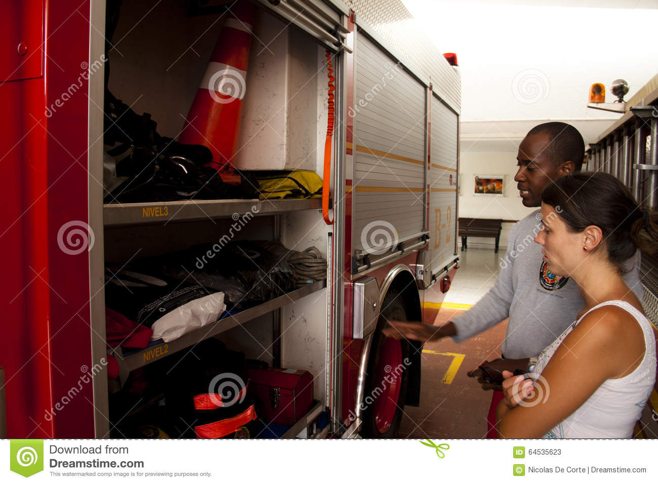 Fireman explaining the different tools in a fire truck