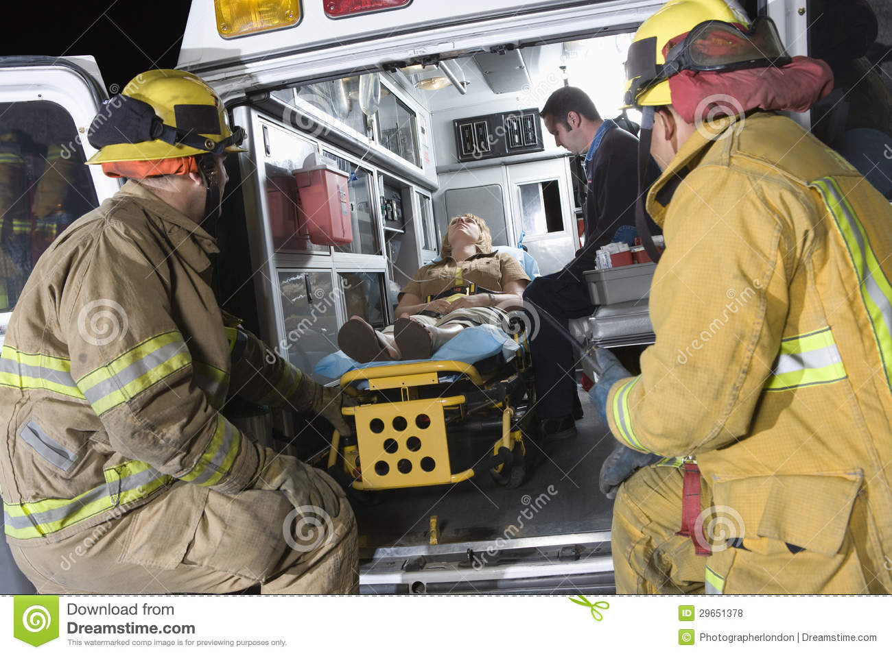 Fireman Looking At Patient And EMT Doctor