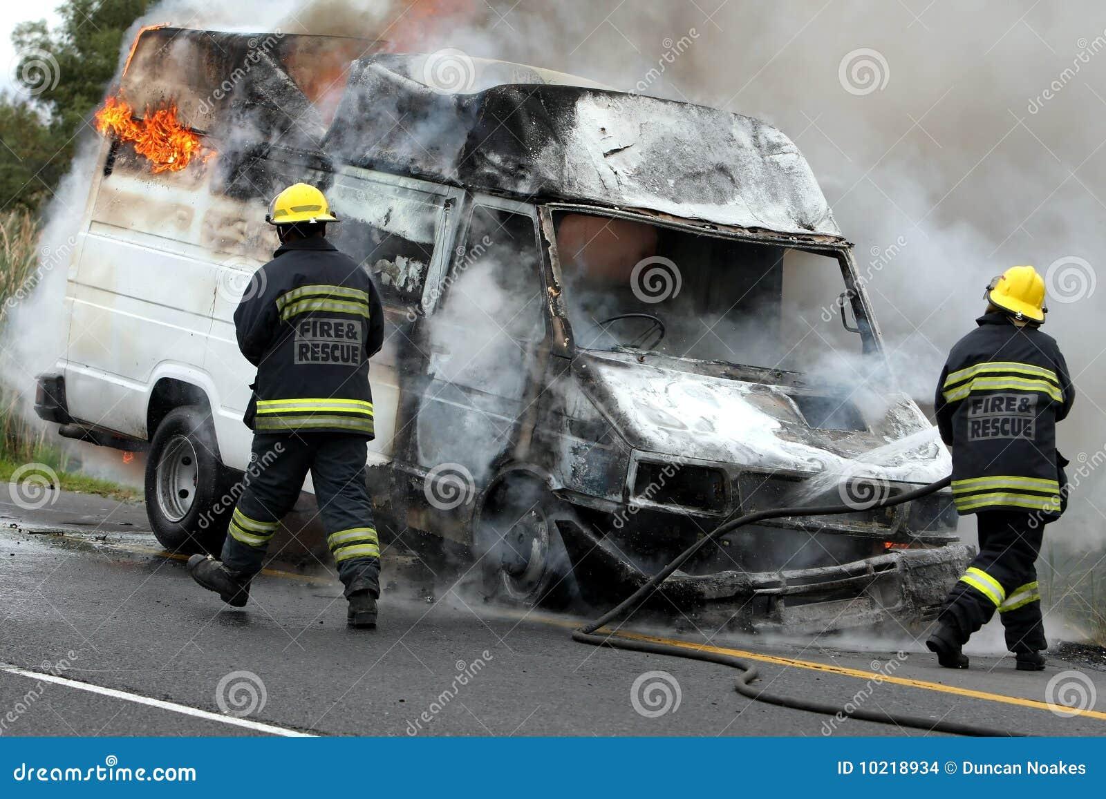 Firemen And Burning Motor Car Stock Images Image 10218934