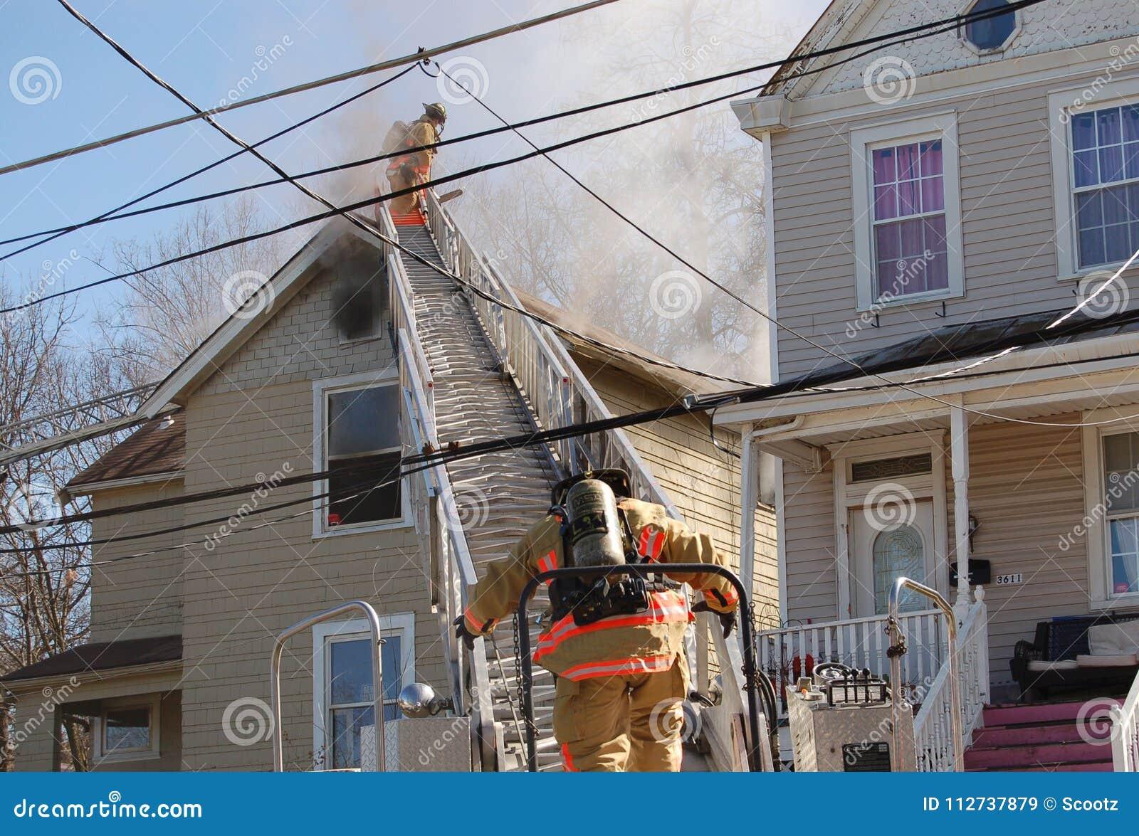Firemen fighting house fire