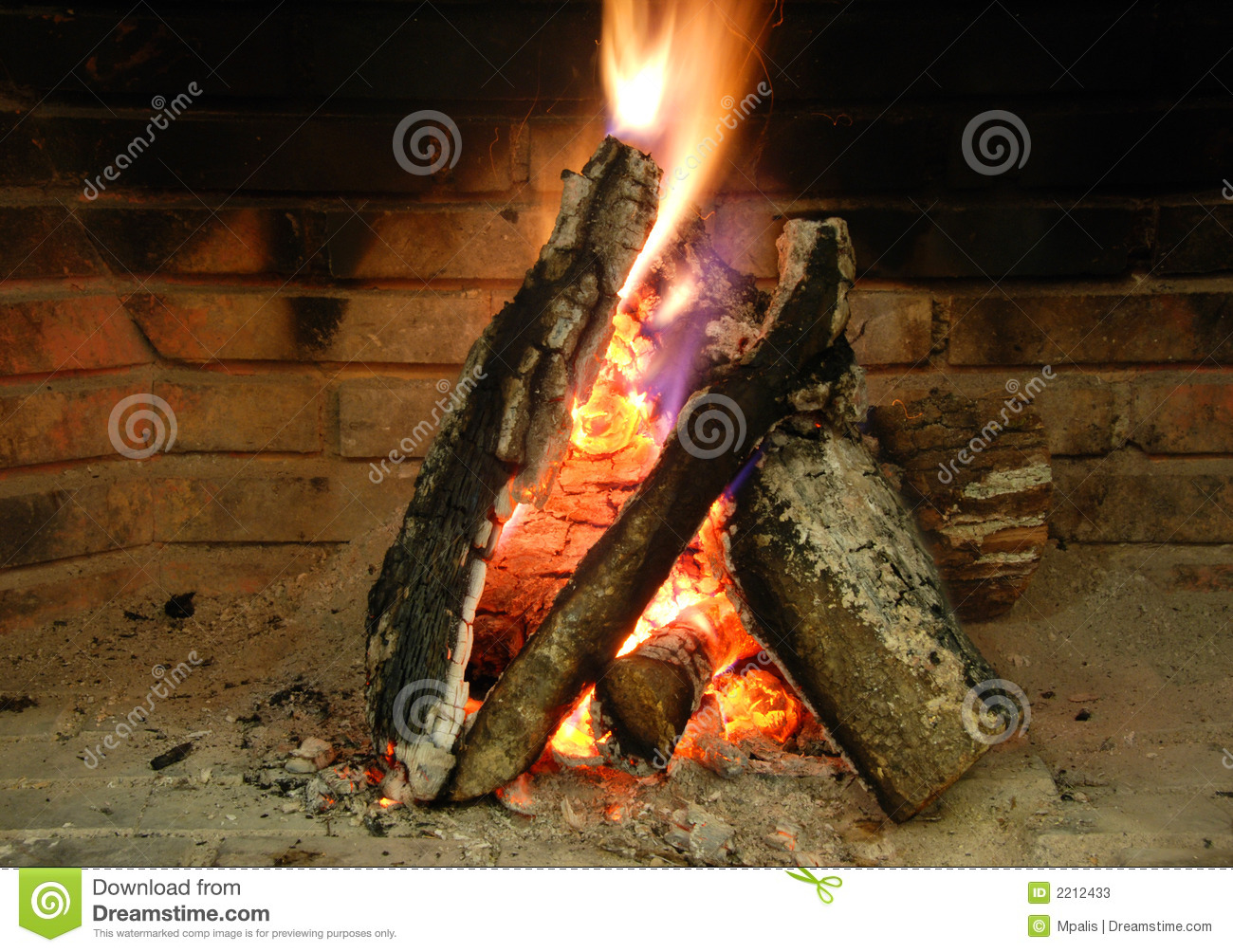 Fireplace with burning woods.