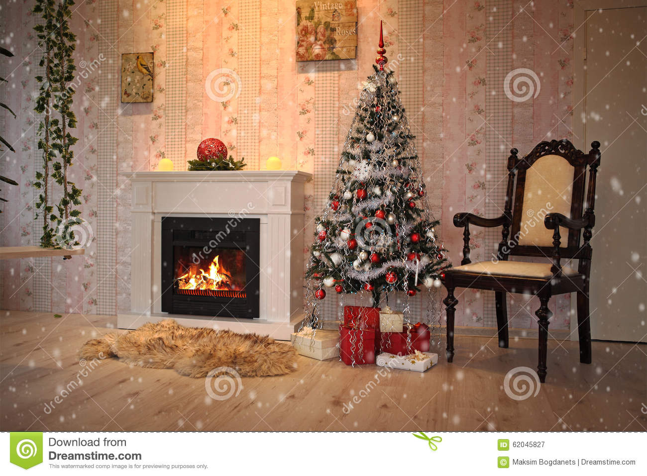 fireplace and christmas tree with presents in living room stock