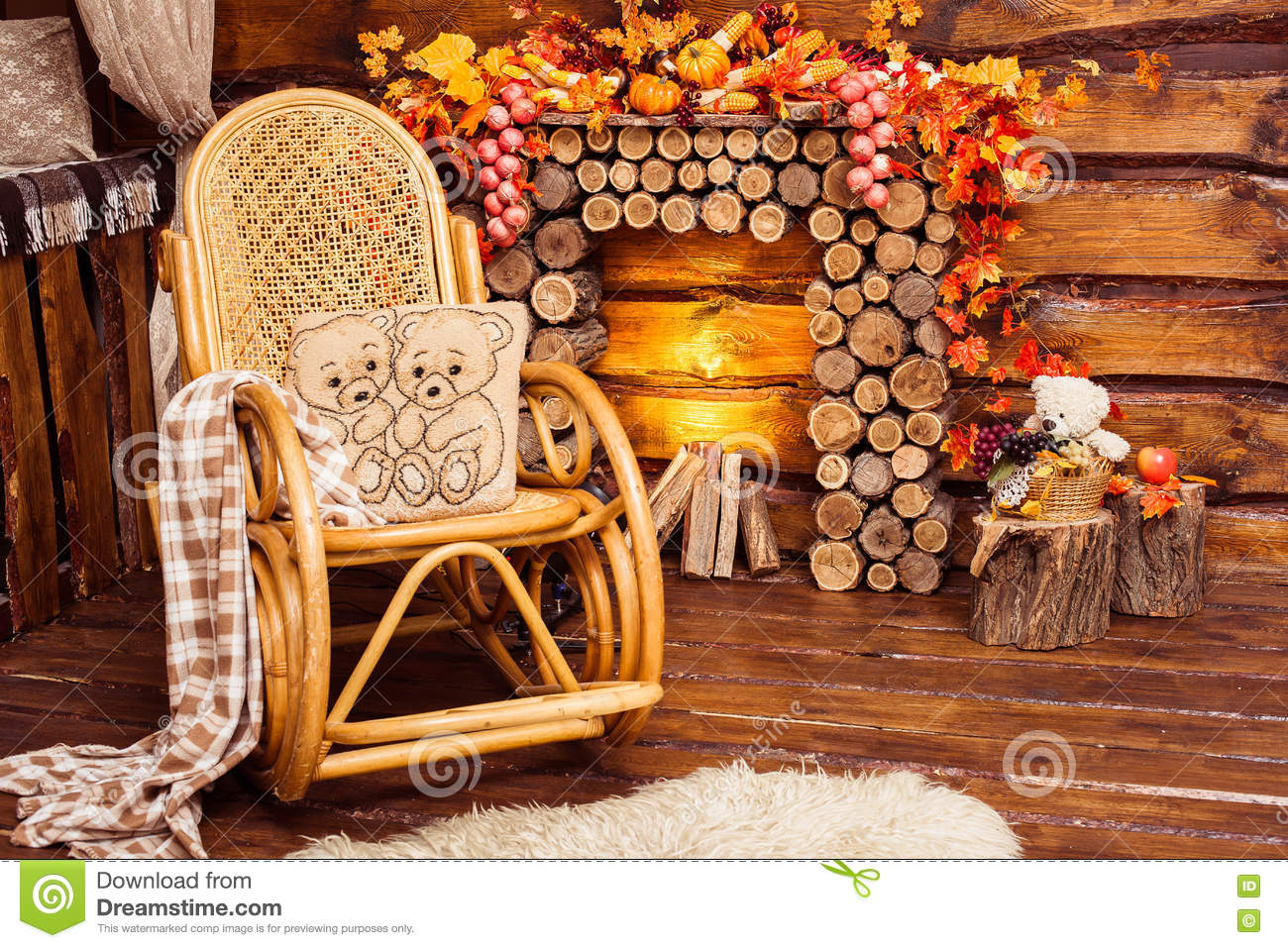 Fireplace Collected From Logs, Rocking-chair And Furs Stock Photo ...