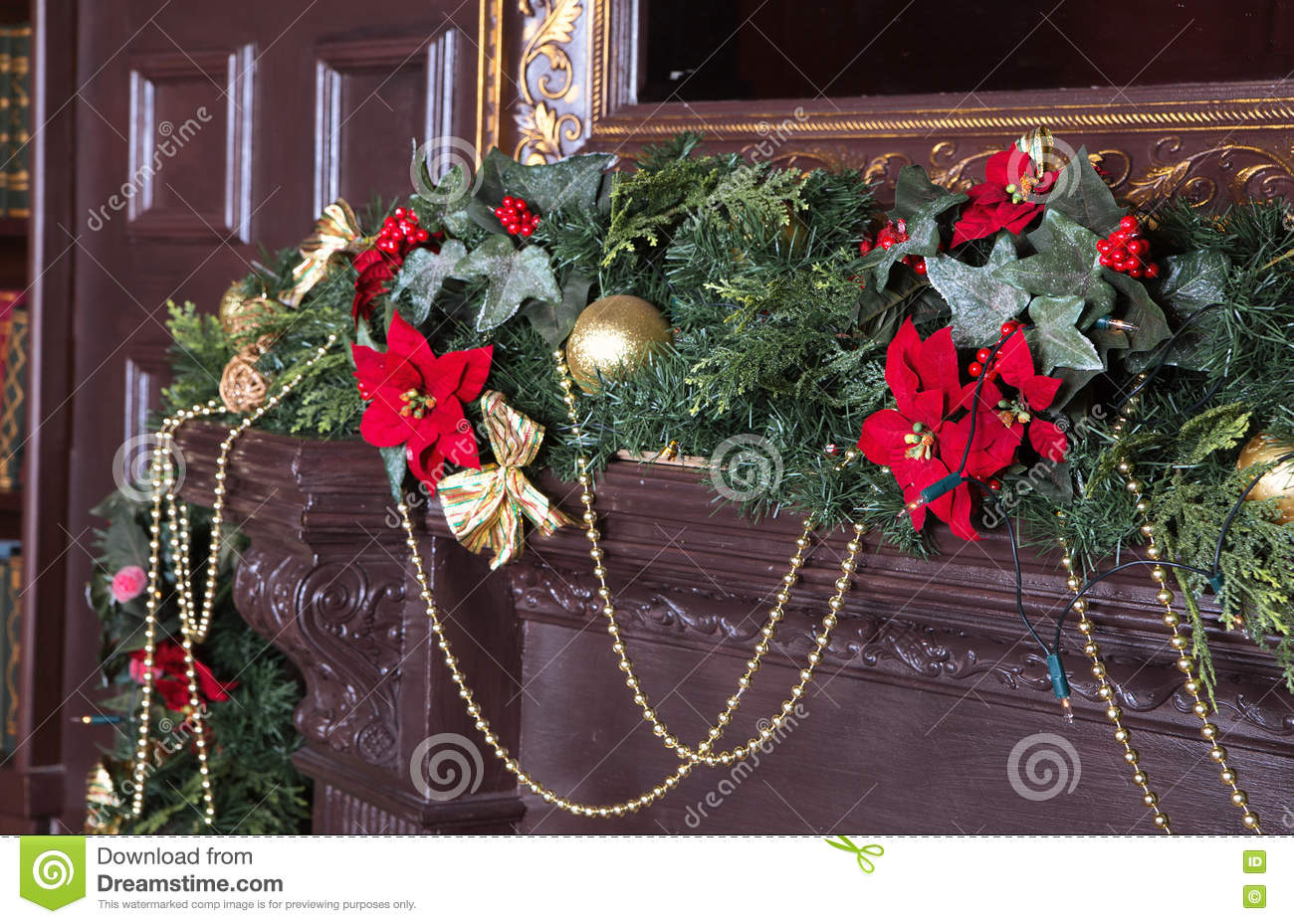 A Fireplace Is Decorated For Christmas With Garland Lights And