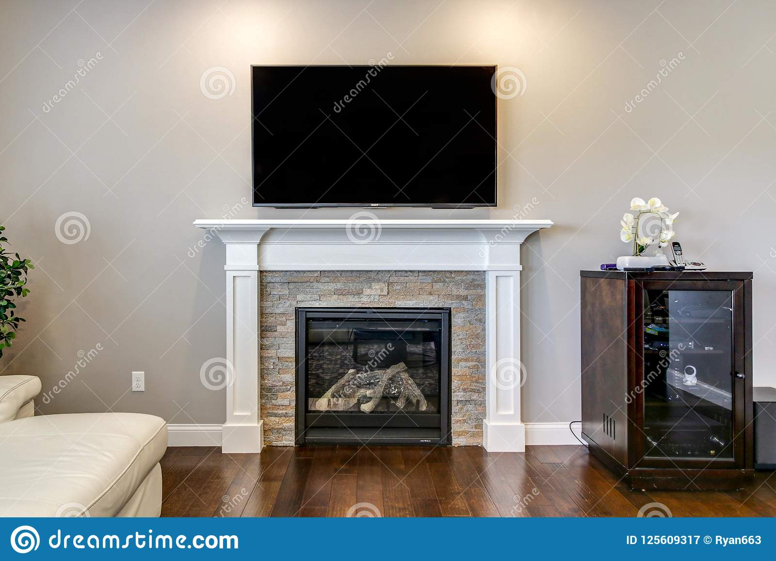 White And Stone Fireplace With Tv Above Stock Image Image Of