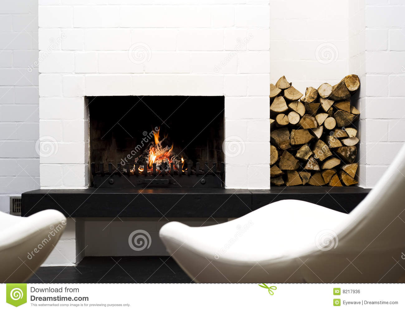 Fireplace wood and lounge chairs stock photo image