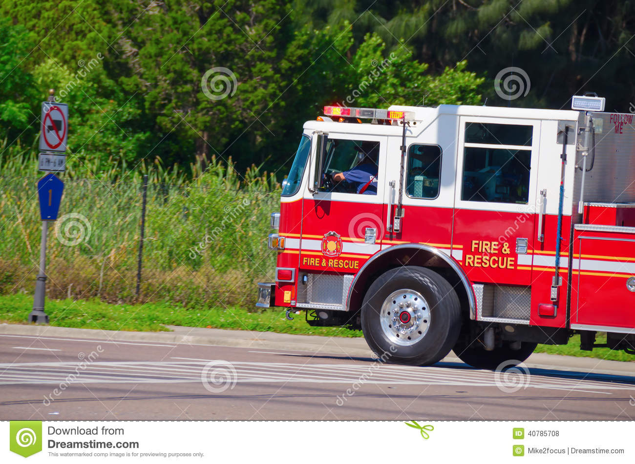 Firetruck driving fast with flashing lights