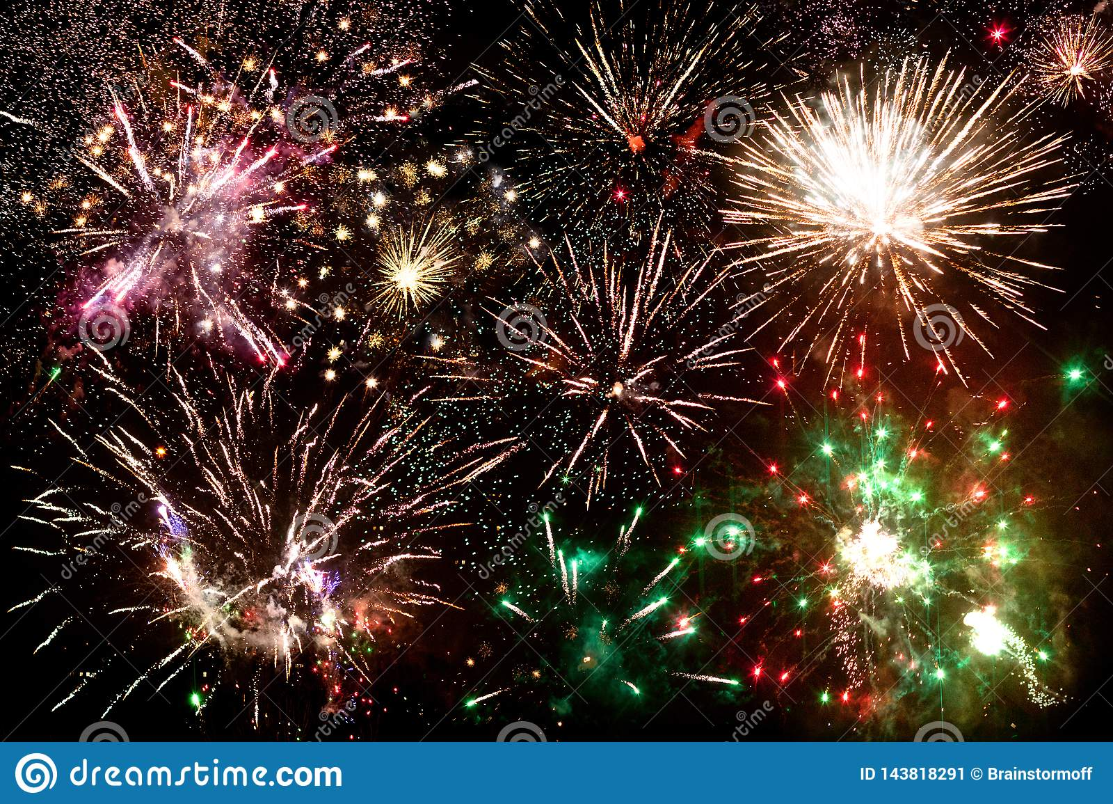 Fireworks, many multicolored salute flashes in the night sky, festive banner, New Year`s poster, Christmas greeting card concept