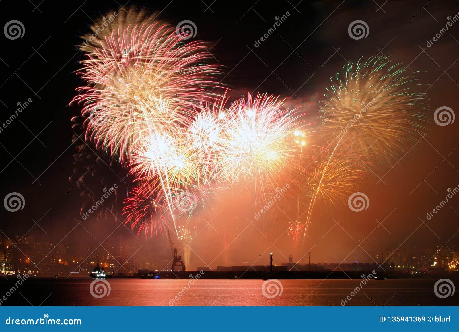 Fireworks over palma de mallorca port to celebrate local patron festivity