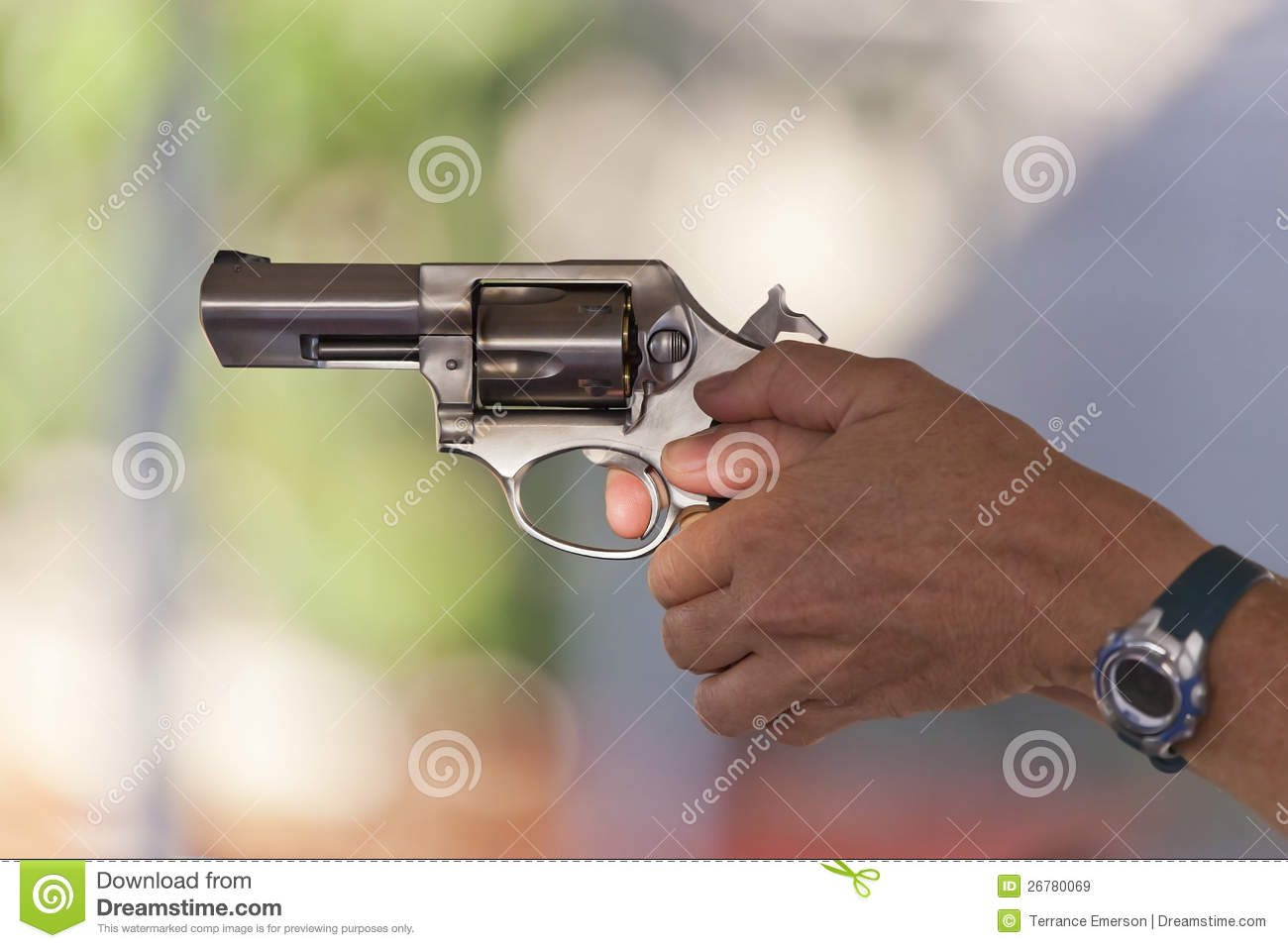 Two Hands Holding A Gun With Finger On The Trigger Stock ...
