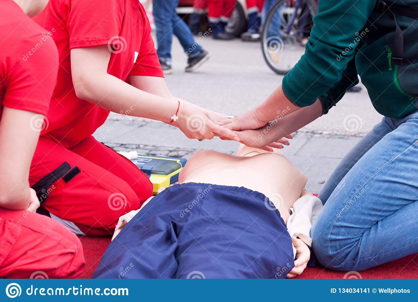 1bba56b6d1 Learning cardiopulmonary resuscitation medical technique, CPR practice on a  dummy during first aid training