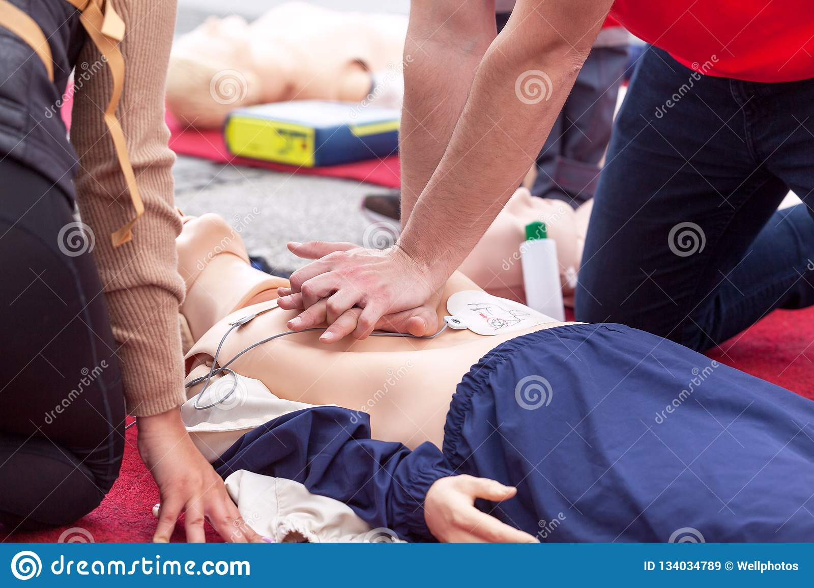 9fef3bbd83 Cardiopulmonary resuscitation - CPR course using automated external  defibrillator device - AED on a dummy