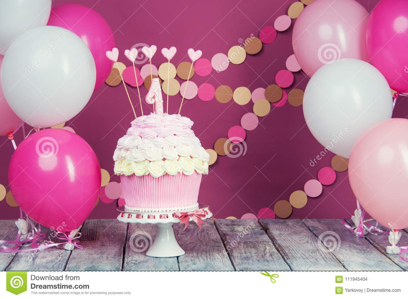 First Birthday Cake With A Unit On A Pink Background With Balls And