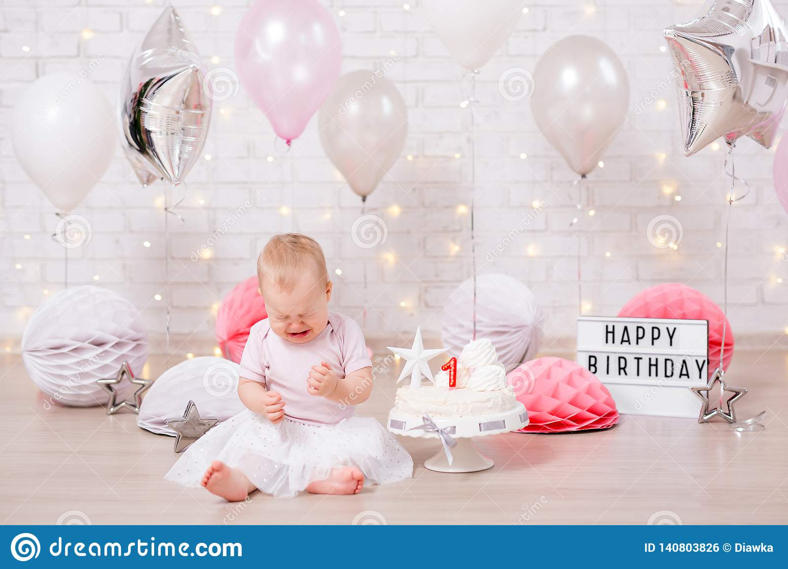 First Birthday Party Concept Sad Little Girl Crying With Cake Balloons And Birthday Decorations Stock Photo Image Of Cream Colorful 140803826