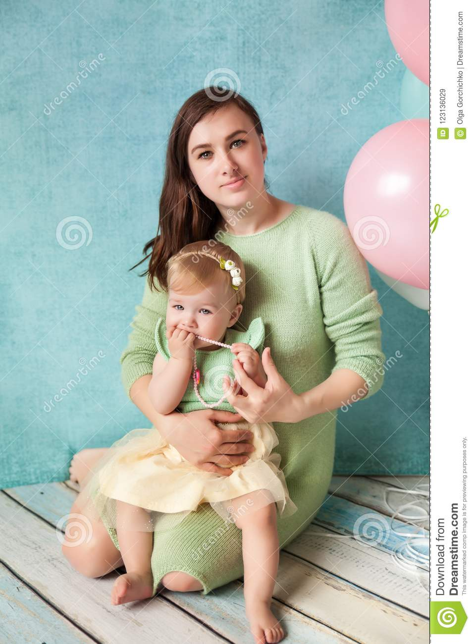 First Birthday Baby Girl In Mint And Yellow Dress With Her Mother Studio Decorated Colorful Balloons Happy Card