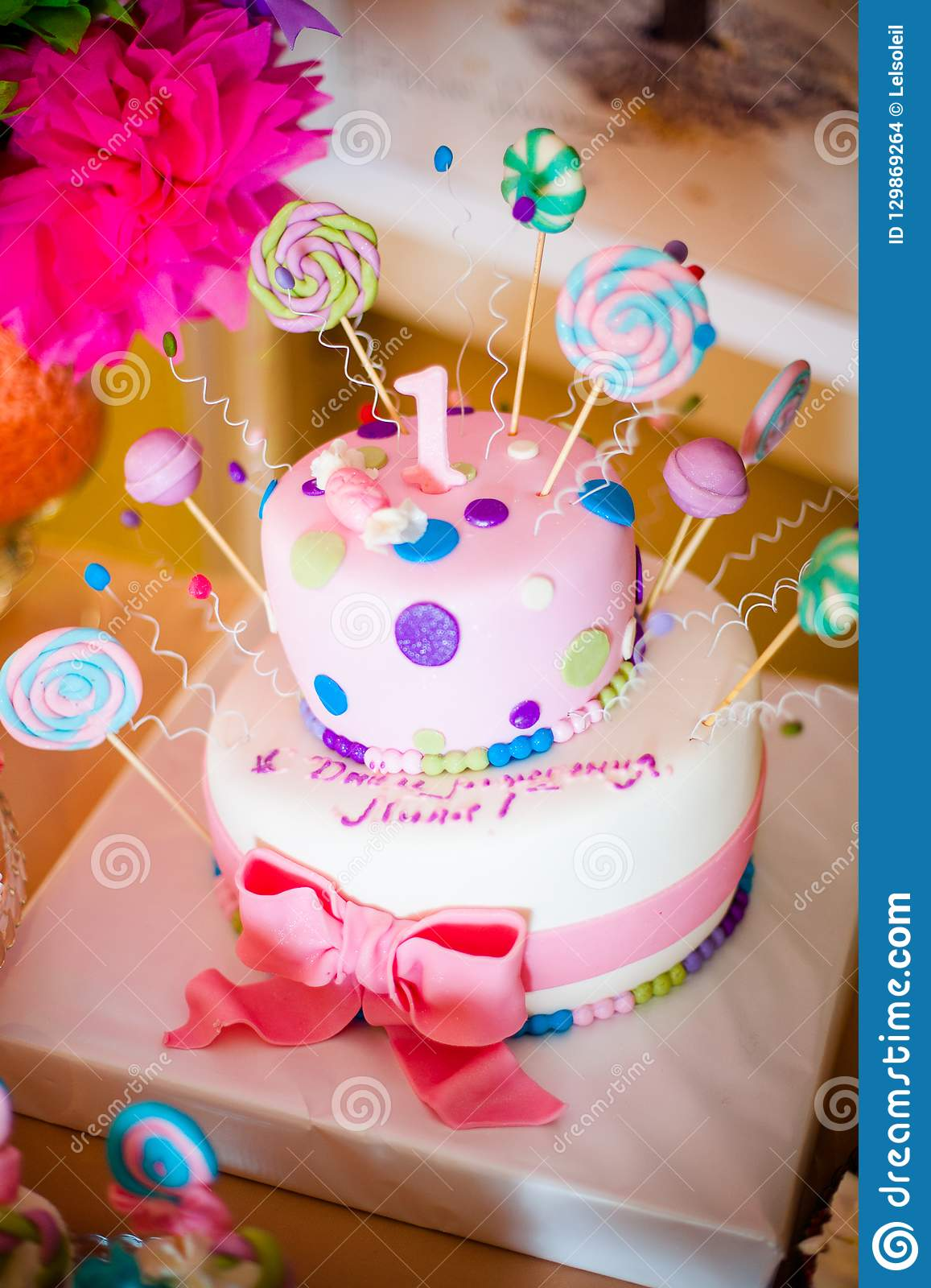 Sensational First Birthday Pink Cake With Lollypops And One Candle For Little Funny Birthday Cards Online Sheoxdamsfinfo
