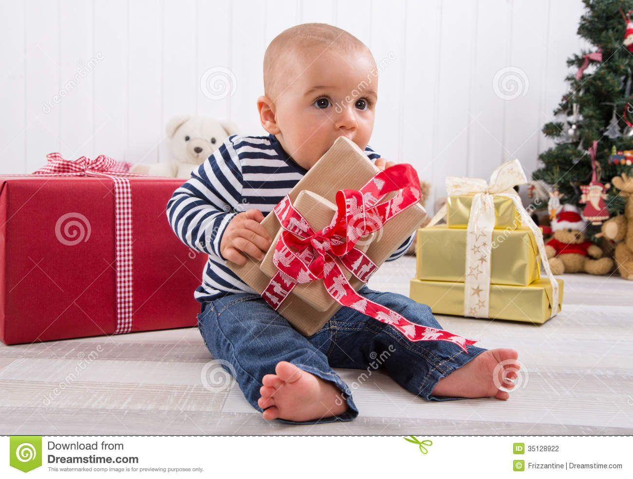 First Christmas: Baby Unwrapping A Present Stock Photo - Image of ...