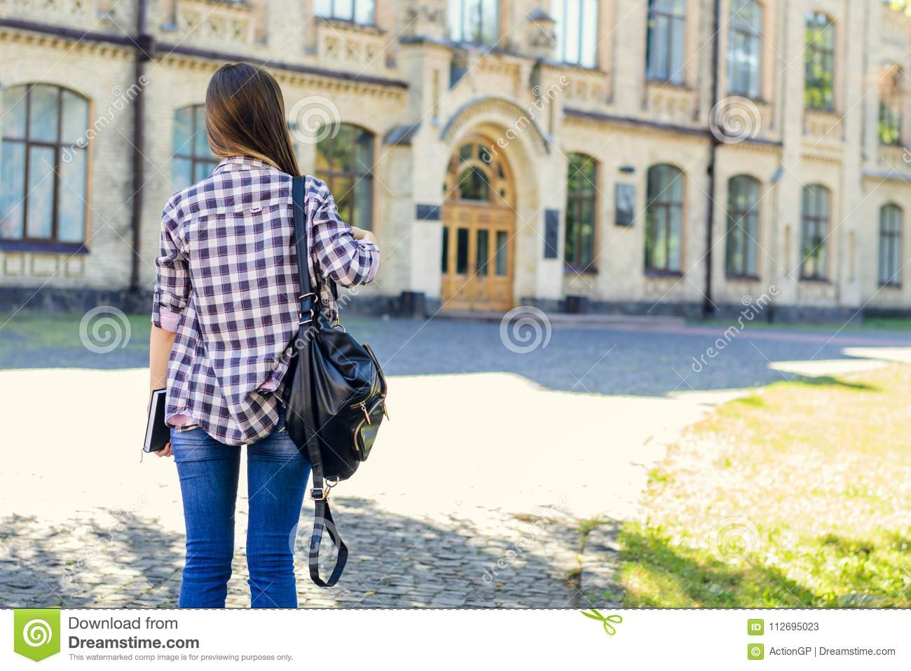First day at university for young happy female student in casual
