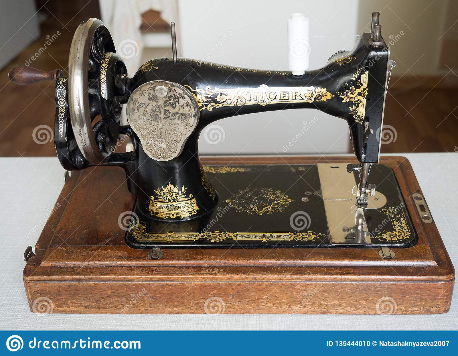 First Hand SINGER Sewing Machine, Selective Focus Editorial