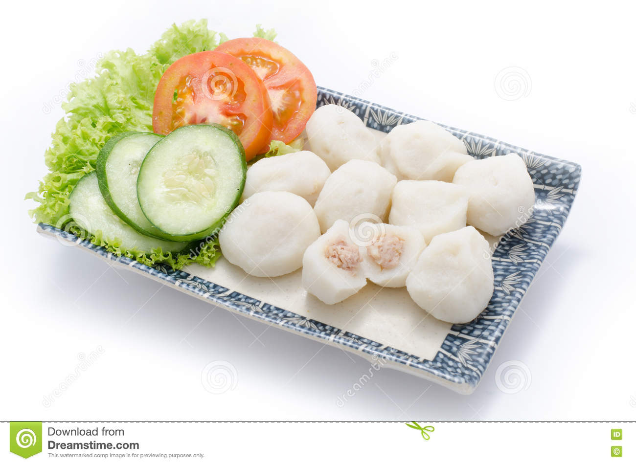 Fish ball with meat and sliced cucumber, tomato, hebs on plate