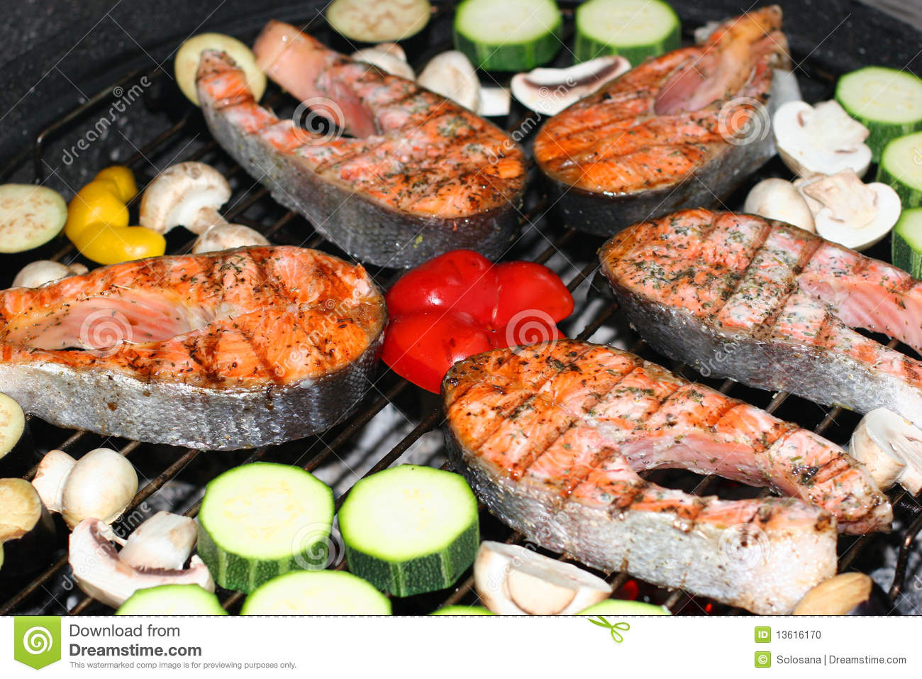 Fresh fish and vegetables prepared on barbecue.