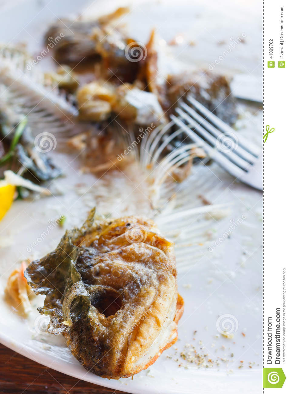Fish bones on a plate stock photo image of background for Fish and bone restaurant