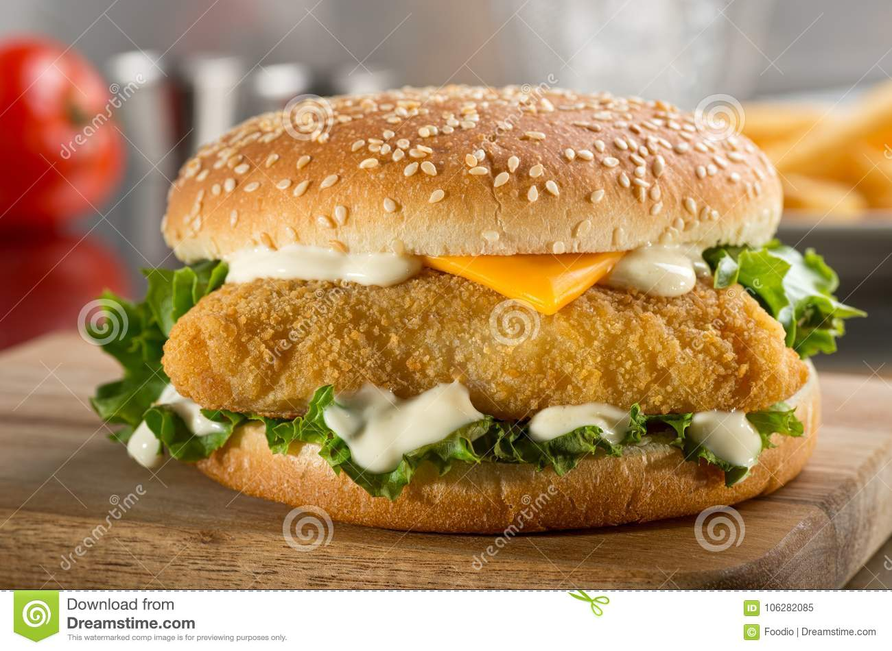 Fish burger with cheese, lettuce, and mayonnaise.
