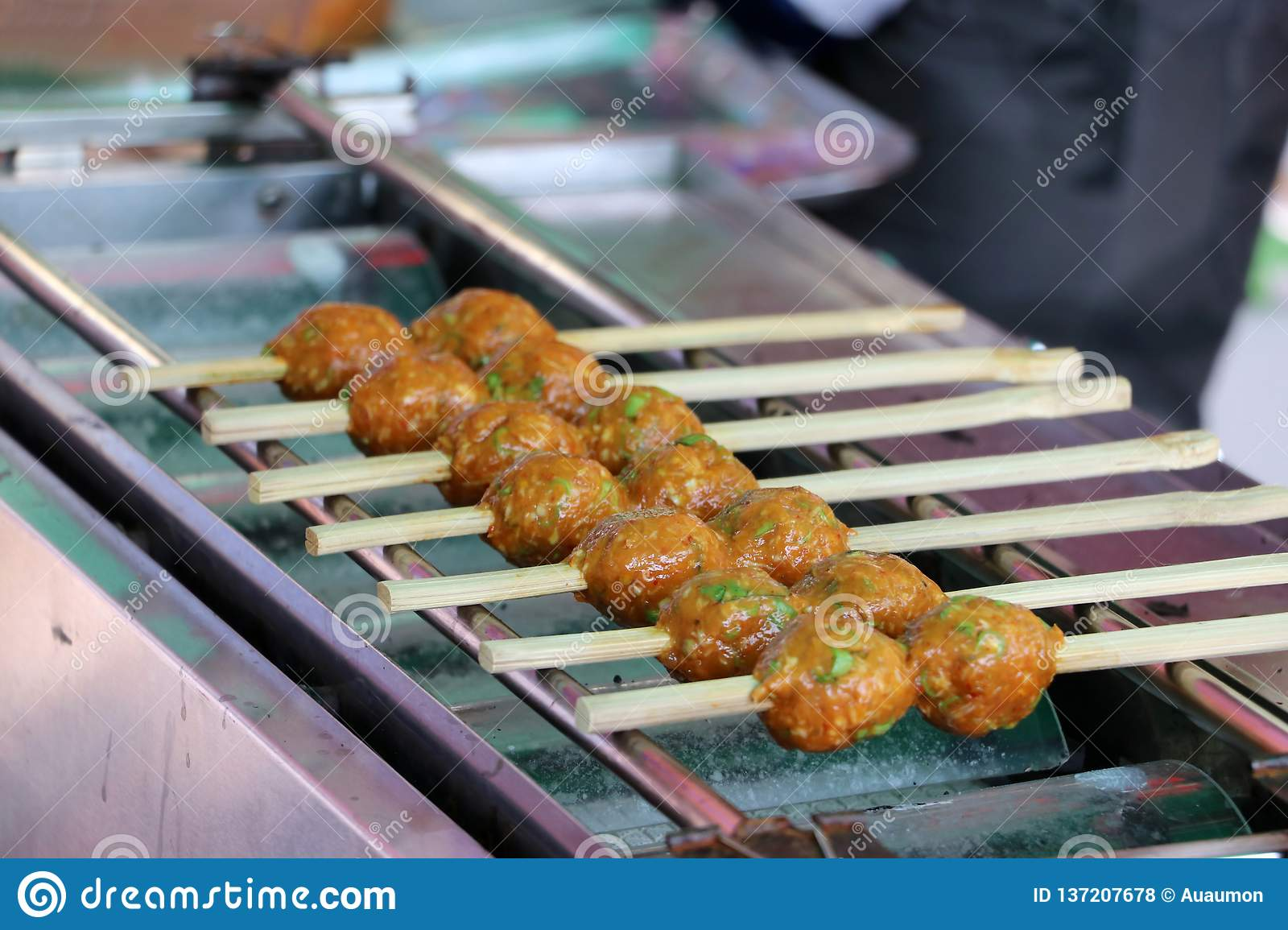 Fish Cake ball through with bamboo grill