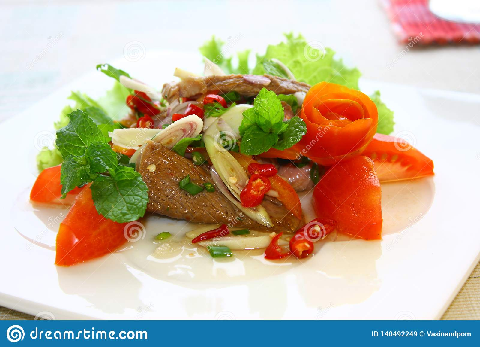 Fish cake, Thai style fish cake served with crispy basil leaf.