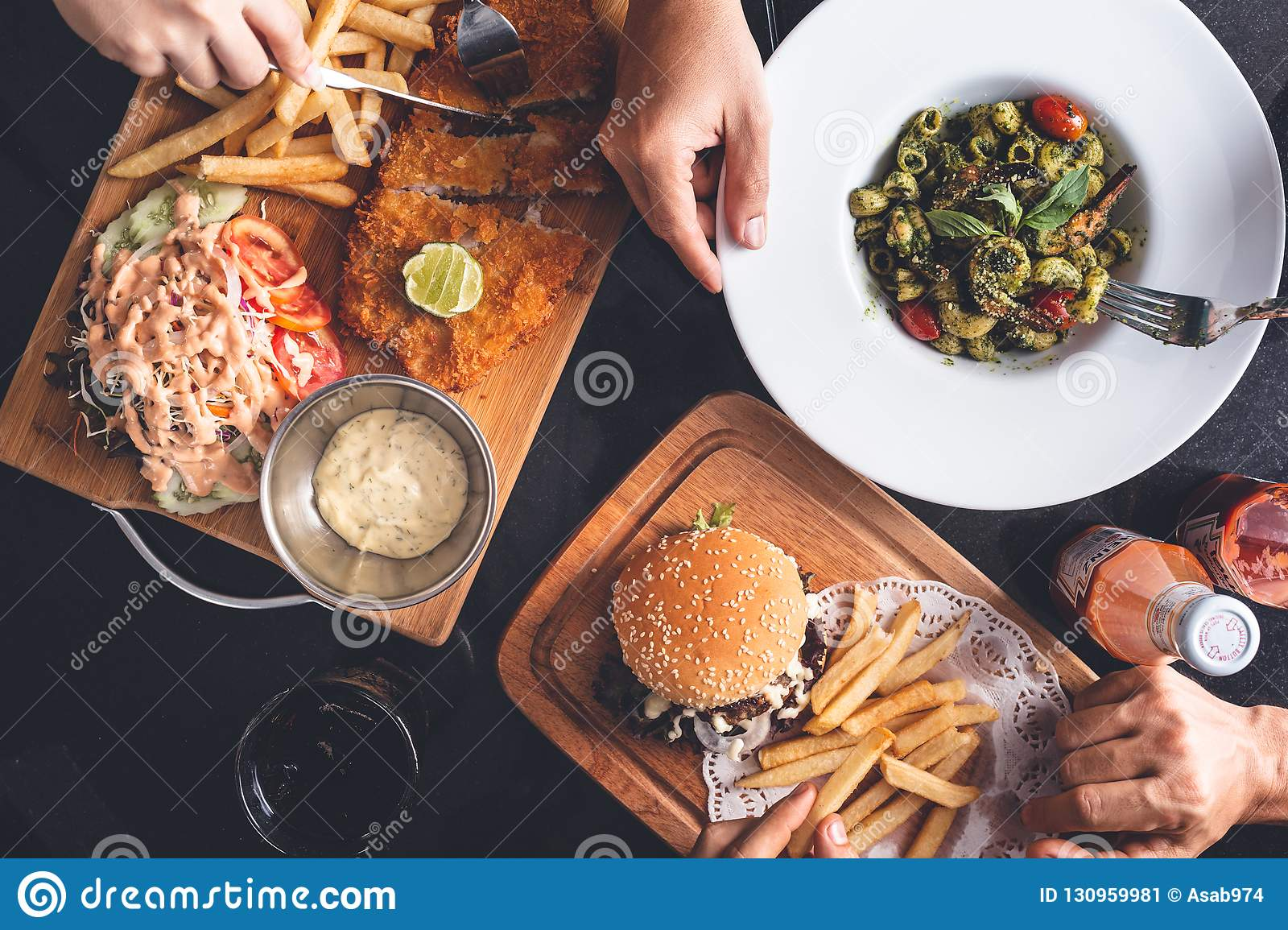 Fish and Chips, Fries and Burger, Pasta Dish on Restaurant Table