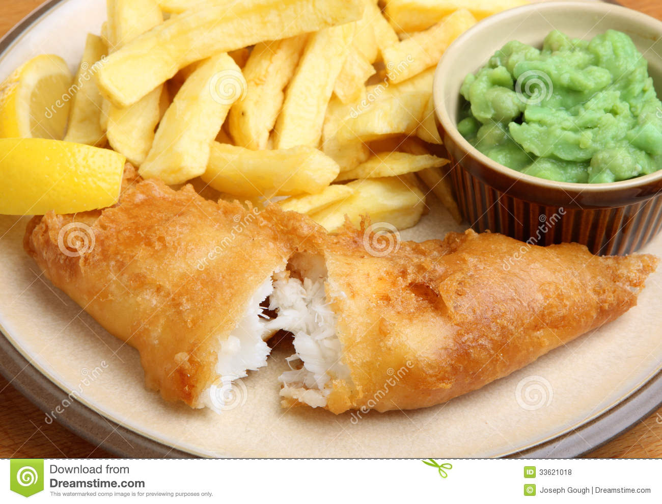 ... cod fillet with chips and mushy peas. Shallow DoF, focus on the fish