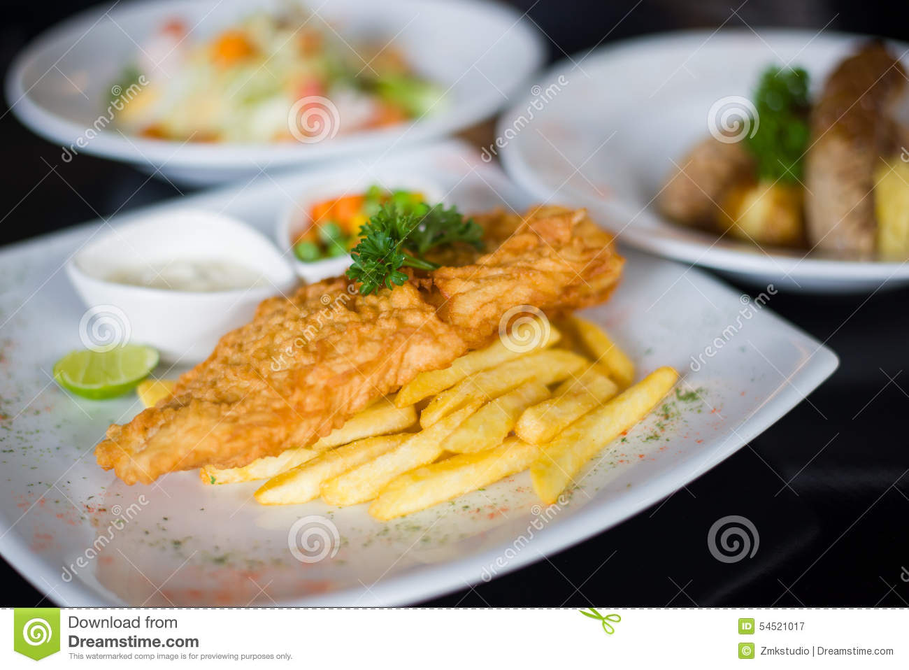 Fish And Chips Served With Tartar Sauce Stock Photo - Image: 54521017