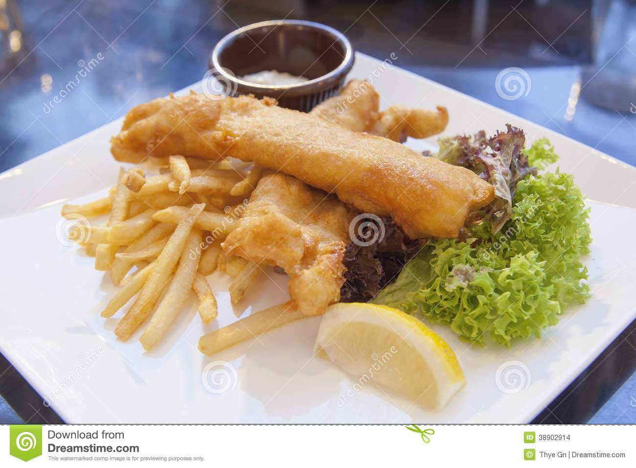 fish and chips with tartar sauce and lettuce. Black Bedroom Furniture Sets. Home Design Ideas