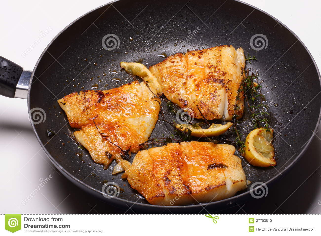 Fish cooking in frying pan stock photo image of near for Cooking white fish