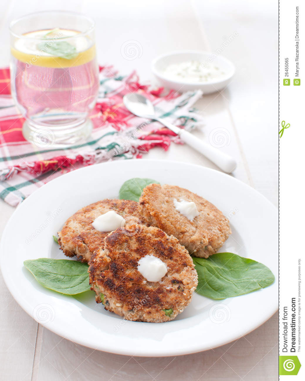 Fish or crab cakes with greens and sauce royalty free for Crab topping for fish