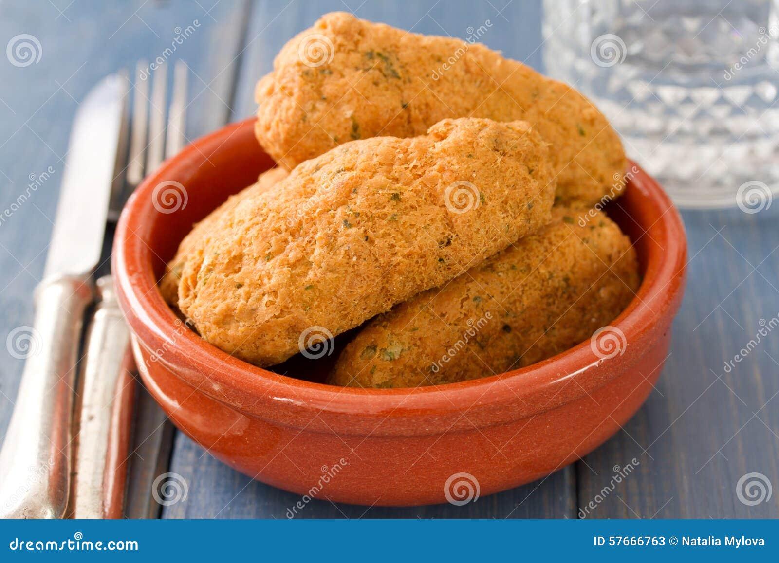 Fish croquettes on dish